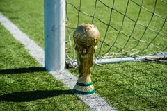 Trophy of the FIFA World Cup. April 9, 2018 Moscow, Russia Trophy of the FIFA World Cup on the green grass of the football field Stock Photography