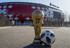 Trophy of the FIFA World Cup. April 9, 2018 Moscow, Russia Trophy of the FIFA World Cup and official ball of FIFA World Cup 2018 Adidas Telstar 18 against the Stock Photo