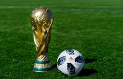 Trophy of the FIFA World Cup. April 9, 2018 Moscow, Russia Trophy of the FIFA World Cup and official ball of FIFA World Cup 2018 Adidas Telstar 18 on the green Royalty Free Stock Photos