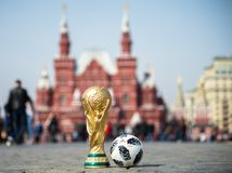 Trophy of the FIFA World Cup. April 16, 2018 Moscow. Russia Trophy of the FIFA World Cup and official ball of FIFA World Cup 2018 Adidas Telstar 18 on the Red Royalty Free Stock Images