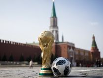 Trophy of the FIFA World Cup. April 16, 2018 Moscow. Russia Trophy of the FIFA World Cup and official ball of FIFA World Cup 2018 Adidas Telstar 18 on the Red Stock Photo