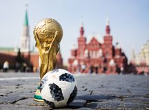 Trophy of the FIFA World Cup. April 16, 2018 Moscow. Russia Trophy of the FIFA World Cup and official ball of FIFA World Cup 2018 Adidas Telstar 18 on the Red Stock Images