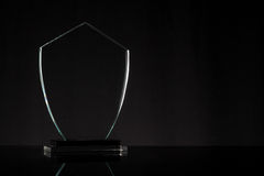 Trophy. Glass trophy in black background Royalty Free Stock Photos