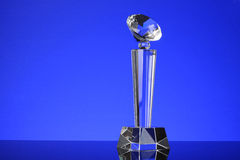 Trophy. Glass trophy in blue background Royalty Free Stock Photo