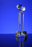 Trophy. Glass trophy in blue background Royalty Free Stock Photos