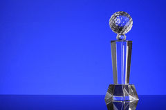 Trophy. Glass trophy in blue background Royalty Free Stock Image