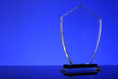 Trophy. Glass trophy in blue background Stock Photography