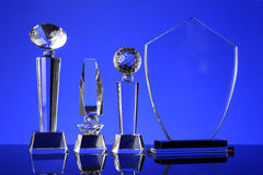 Trophy. Glass trophy in blue background Stock Photo