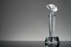 Trophy. Glass trophy in gray background Royalty Free Stock Photography