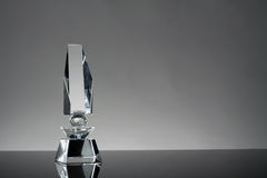 Trophy. Glass trophy in gray background Royalty Free Stock Photos