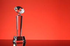 Trophy. Glass trophy in red background Stock Photos