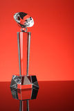 Trophy. Glass trophy in red background Royalty Free Stock Photography