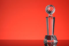 Trophy. Glass trophy in red background Stock Image