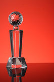 Trophy. Glass trophy in red background Stock Photo