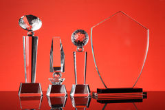 Trophy. Glass trophy in red background Royalty Free Stock Image
