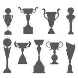 Trophy icons isolated on white background. Award cups silhouettes. Royalty Free Stock Images