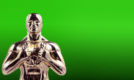 Trophy Man on Green royalty free stock images
