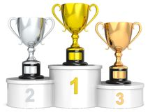 Trophy podium. White podium with 3 Trophy cups Stock Photos