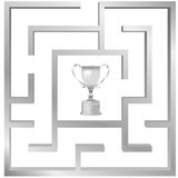 Trophy prize as award for maze problem solution. A trophy symbol of a prize or award for the solution of a maze problem Stock Photos