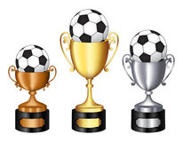 Trophy with soccer ball. Gold silver and bronze champion trophy  with soccer ball on it for 1st, 2nd, and 3rd places isolated on white background Royalty Free Stock Photo
