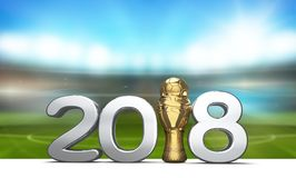 2018 trophy with a soccer football ball as 3d rendering. With blurred soccer football stadium design Stock Photos