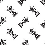 Trophy star cup and award icon seamless pattern. Tiling ornament on white. Vector illustration Stock Image