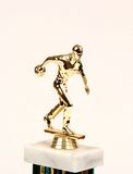 Trophy topper. Top of a bowling trophy showing figure of a man bowling Stock Images