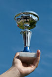 Trophy Winner. Silver cup trophy held proudly after winning  a contest Royalty Free Stock Photo
