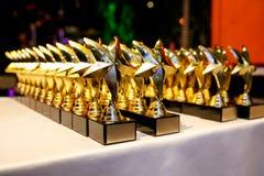 Trophys de oro, premios bajo la forma de estrellas foto de archivo