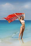 Tropi Girl. Beauty Girl in white swim suite and red pareo stock image