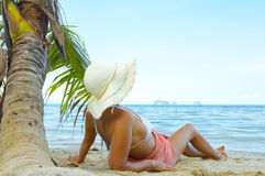 Tropic bliss. View of nice woman having fun on tropical beach Royalty Free Stock Image