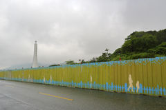 Tropic of cancer tower at hualien county, taiwan in rain. Royalty Free Stock Images