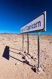 Tropic of Capricorn marking sign as it passes through Namibia desert royalty free stock photos
