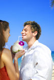 Tropic drink. A portrait of attractive couple having date on the beach Stock Photography