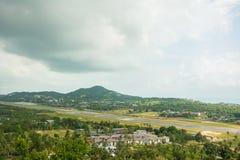 Tropic island Samui, sea and airport, Thailand panorama viewpoint view. Airstrip at tropical island Koh Samui under clouds, aerial view. Thailand panorama royalty free stock photos