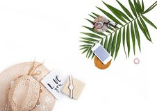 Tropic palm leaf, straw hat, glasses and handwritten card `love. You`. Flat lay, top view. Summer travel concept Stock Images