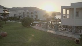 Tropic Resort View. Tropic resort pool against sealine and daybreak light in morning stock footage