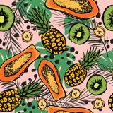 Tropic seamless pattern with exotic fruits and leaves. stock image