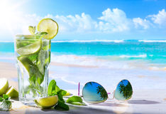 Tropic summer vacation; Exotic drinks on blur tropical beach bac Royalty Free Stock Images