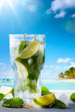 Tropic summer vacation; Exotic drinks on blur tropical beach bac Royalty Free Stock Photos