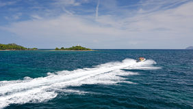 Tropical adventure with speedboat Stock Photography