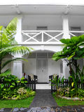 Tropical antique colonial house with landscaping Royalty Free Stock Photo