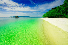 Tropical Asian paradise. Stretch of white sandy beach in tropical paradise Royalty Free Stock Photo
