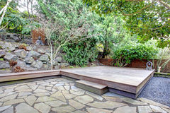 Tropical back yard with a wooden deck Stock Photography