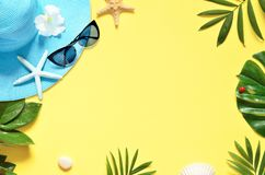 Tropical Background. Palm Trees Branches with starfish and seashell on yellow background. Travel. Copy space. royalty free stock image