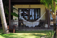 Tropical balcony. Resort balcony with a net bed mounted Stock Images