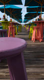 Tropical Bar. A tropical outdoor restaurant with brightly colored tables and stools Royalty Free Stock Photos