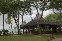 A Tropical Bar. This is one of the bars of hotel Baobab Beach Resort & Spa which is near Mombasa, Kenya on the Indian ocean shore, Africa royalty free stock photo
