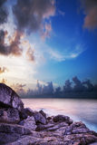 Tropical bay at sunset time. Royalty Free Stock Photo