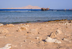 Tropical bay with a wooden jetty or pier Stock Photos